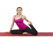 Young woman stretching her legs Stock Image