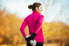 Young woman stretching before her run Stock Photography