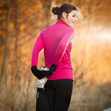 Young woman stretching before her run Stock Photos