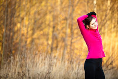 Young woman stretching before her run Royalty Free Stock Photos