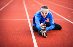 Woman stretching before her run Stock Photography