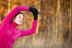 Young woman stretching before her run outdoors Royalty Free Stock Images