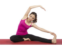 Young woman stretching her upper body Stock Images