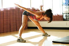 Young Woman Stretching In Work Out Room Royalty Free Stock Image