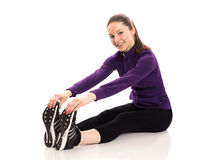 Young woman stretching isolated Stock Image