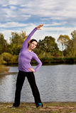Stretching woman Royalty Free Stock Image