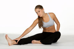 Young Woman Stretching Leg Royalty Free Stock Images