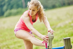 Young woman stretching leg Royalty Free Stock Photo