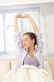 Young woman stretching in morning Stock Image