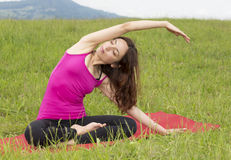 Young woman stretching in nature Royalty Free Stock Photos