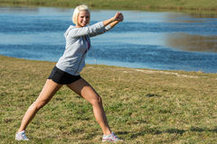 Young woman stretching outdoors before jogging Stock Photos