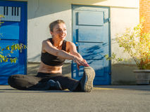 Young woman stretching outdoors Royalty Free Stock Photos