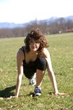 Young woman stretching in a park Stock Photography