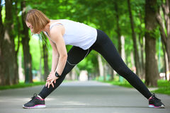 Young woman stretching in the park. Stock Photography