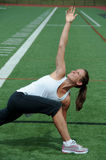 Young Woman Stretching on Playing Field Royalty Free Stock Photography