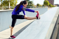 Young woman stretching and preparing for running Stock Photo