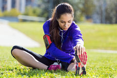 Young woman stretching and preparing for running Stock Image