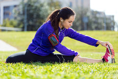 Young woman stretching and preparing for running Royalty Free Stock Images