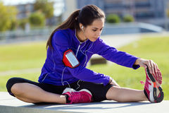 Young woman stretching and preparing for running Royalty Free Stock Photo