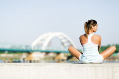 Young woman stretching and relaxing in the city Royalty Free Stock Image
