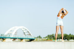 Young woman stretching and relaxing in the city Stock Photos