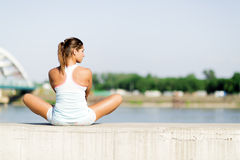 Young woman stretching and relaxing in the city Royalty Free Stock Photography