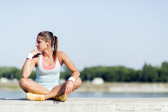Young woman stretching and relaxing in the city Royalty Free Stock Images