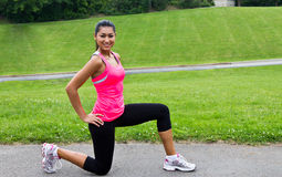 Young woman stretching before a run Stock Photos