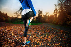 Young woman stretching before running Stock Image