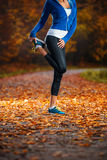 Young woman stretching before running in the early evening in th Royalty Free Stock Photos