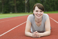 Young woman stretching on running track Royalty Free Stock Photos