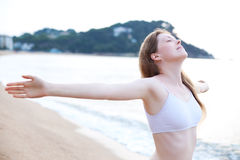 Young woman stretching Royalty Free Stock Photography