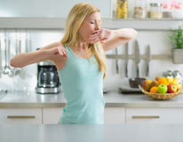 Young woman stretching after sleep in kitchen Stock Image