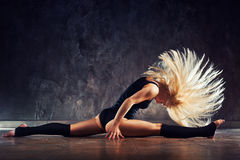 Young woman stretching Stock Photography