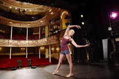 Young Woman Stretching On Stage Royalty Free Stock Photos