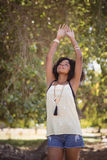 Young woman stretching while standing on field Royalty Free Stock Photo