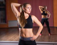 Young Woman Stretching in Studio with Mirrors Royalty Free Stock Image