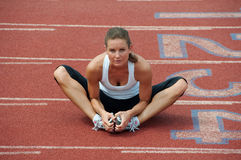 Young Woman Stretching on Track Royalty Free Stock Photography