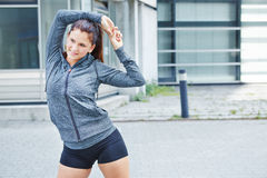 Young woman stretching before training royalty free stock photography