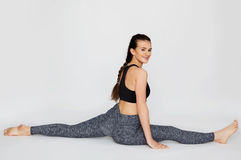 Young woman stretching in twine Royalty Free Stock Images