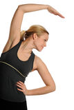 Young Woman stretching during work out Royalty Free Stock Photography