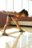Young woman stretching in work out room Stock Images