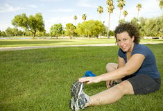 Young woman stretching before Working Out Royalty Free Stock Photo