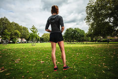 Young woman stretching and working out in park Royalty Free Stock Photos