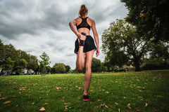 Young woman stretching and working out in park Royalty Free Stock Photo