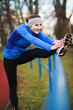 Young woman stretching Stock Photos