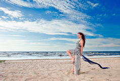 Young woman in striped dress Stock Photography