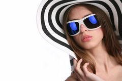 Young woman in striped hat Stock Images