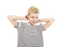 Young woman in striped tee shirt. Young woman in striped tee shirt posing emotionally on white background. Isolated image, Studio shot on white background Royalty Free Stock Photo