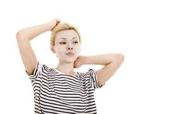 Young woman in striped tee shirt. Young woman in striped tee shirt posing emotionally on white background. Isolated image, Studio shot on white background Stock Images